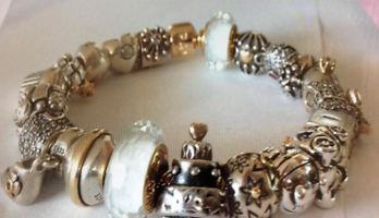 AUTHENTIC 14 CARAT GOLD PANDORA BRACELET AND 2 TONED CHARMS