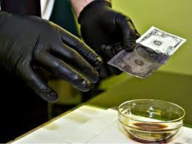 ** Solution for Cleaning Defaced Banknotes **